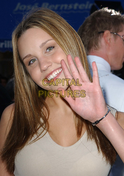 AMANDA BYNES.Arriving @ The ' Matrix Reloaded' LA Premiere held at The Mann Village Theater in Westwood.                            .headhsot, portrait, waving.www.capitalpictures.com.sales@capitalpictures.com.©Capital Pictures