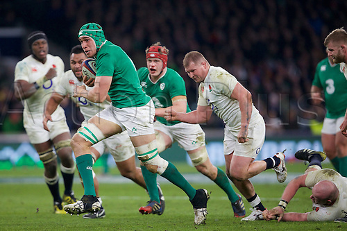 27.02.2016. Twickenham, London, England. RBS Six Nations Championships. England versus Ireland. Ireland lock Ultane Dillane runs with the ball from England hooker Dylan Hartley.