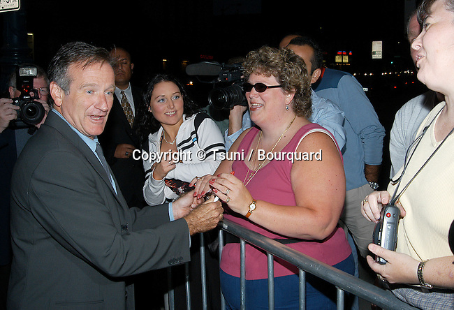 "Robin Williams signing autograph at the premiere of ""One Hour Photo"" at the Academy of Motion Picture Arts and Sciences in Los Angeles. August 22, 2002.          -            WilliamsRobin03.jpg"