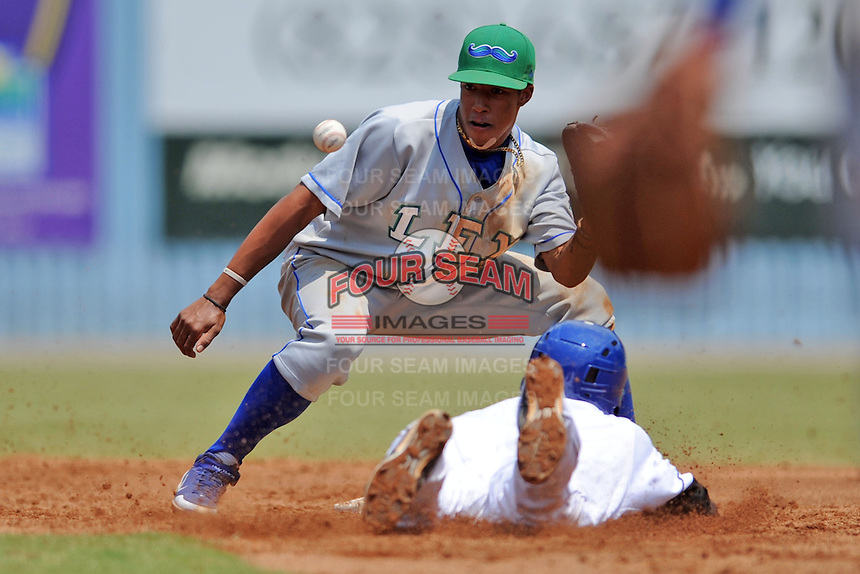 Lexington Legends shortstop Raul Mondesi #2 attempts to apply a tag as Juan Ciriaco #2 slides in safely during a game against the Asheville Tourists at McCormick Field on June 16, 2013 in Asheville, North Carolina. The Tourists won the game 8-7. (Tony Farlow/Four Seam Images)