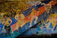 Afro-Cuban traditional themes, showing colorful drummers, painted on a house wall in Santiago de Cuba, Cuba, August 2, 2009. The Palo religion (Las Reglas de Congo) belongs to the group of syncretic religions which developed in Cuba amongst the black slaves, originally brought from Congo during the colonial period. Palo, having its roots in spiritual concepts of the indigenous people in Africa, worships the spirits and natural powers but can often give them faces and names known from the Christian dogma. Although there have been strong religious restrictions during the decades of the Cuban Revolution, the majority of Cubans still consult their problems with practitioners of some Afro Cuban religion.