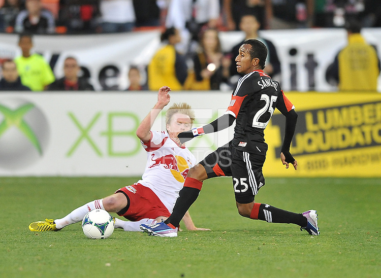 Marcos Sanchez (25) of D.C. United goes against Dax McCarty of The New York Red Bulls (11) The New York Red Bulls defeated D.C. United  2-0, at RFK Stadium, Saturday April 13, 2013.