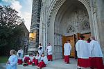 The Duke Evensong Singers gather for rehearsal outside Duke Chapel on a Fall evening.
