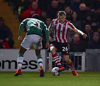 Lincoln City's Harry Anderson looks to get past Yeovil Town's Josh Grant<br /> <br /> Photographer Andrew Vaughan/CameraSport<br /> <br /> The EFL Sky Bet League Two - Lincoln City v Yeovil Town - Friday 8th March 2019 - Sincil Bank - Lincoln<br /> <br /> World Copyright © 2019 CameraSport. All rights reserved. 43 Linden Ave. Countesthorpe. Leicester. England. LE8 5PG - Tel: +44 (0) 116 277 4147 - admin@camerasport.com - www.camerasport.com