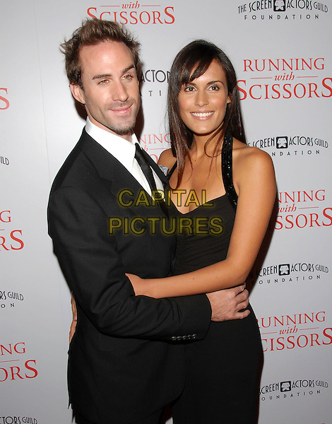 "JOSEPH FIENNES & GUEST.attends The TrisStar Pictures' World Premiere of ""Running with Scissors"" held at The Academy of Motion Pictures Arts & Sciences in Beverly Hills, California, USA, October 10th 2006..half length black dress.Ref: DVS.www.capitalpictures.com.sales@capitalpictures.com.©Debbie VanStory/Capital Pictures"