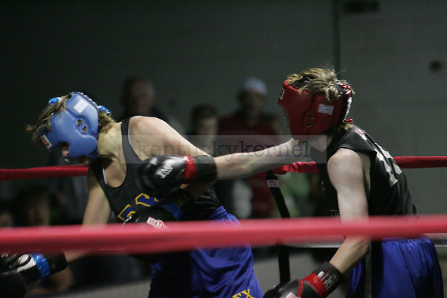 Joseph Kaseta (R) of Triangle punches Adam Shipley (L) of Sigma Chi during their bout at The Main Event, where proceeds benefitted The Huntsman Cancer Institute and The Ronald McDonald House in Lexington, Ky. on 11/11/11. Photo by Quianna Lige | Staff
