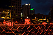 An eager fan sneaks a peek at the Avett Brothers during a show in downtown Pittsburgh, PA, Saturday, June 21, 2008.