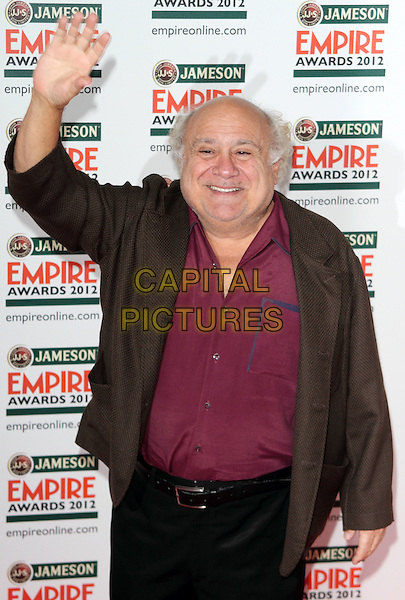 Danny DeVito.Jameson Empire Film Awards at the Grosvenor House Hotel, Park Lane, London, England..March 25th 2012.half length hand arm in air waving brown jacket pink shirt  .CAP/ROS.©Steve Ross/Capital Pictures