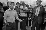 Appleby in Westmorland traditional annual gypsy Horse Fair Cumbria. 1981. The man in the foreground (left with smiling gap tooth) is the 'banker' who throws the two pennies up. His colleague also works with him.