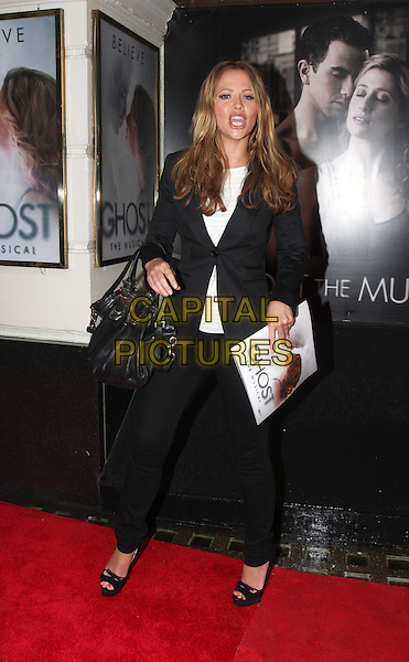 Kimberley Walsh.'Ghost - The Musical' Opening Night at the Piccadilly Theatre, London, England..July 19th 2011.full length white top black suit jacket trousers bag purse.CAP/ROS.©Steve Ross/Capital Pictures