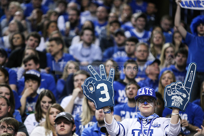A Kentucky fan holds up foam signs during the second half of the Kentucky vs. Florida game at Rupp Arena in Lexington, Ky.,on Saturday, March 7, 2015. UK defeated Florida 67-50, completing a perfect regular season. Photo by Adam Pennavaria | Staff
