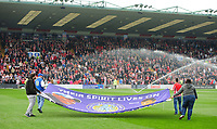 Lincoln City and Macclesfield Town fans with a flag paying tribute to Keith Alexander and Richard Butcher prior to the game<br /> <br /> Photographer Chris Vaughan/CameraSport<br /> <br /> The EFL Sky Bet League Two - Lincoln City v Macclesfield Town - Saturday 30th March 2019 - Sincil Bank - Lincoln<br /> <br /> World Copyright © 2019 CameraSport. All rights reserved. 43 Linden Ave. Countesthorpe. Leicester. England. LE8 5PG - Tel: +44 (0) 116 277 4147 - admin@camerasport.com - www.camerasport.com