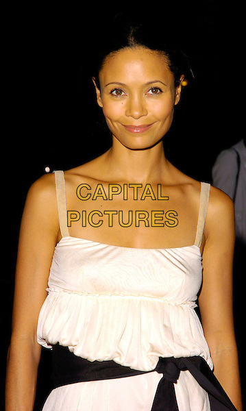 "THANDIE NEWTON.The ""Portraits from the Gap Collection"" gala preview, National Portrait Gallery, London, UK..September 6th, 2006.Ref: CAN.half length white dress ribbon black belt .www.capitalpictures.com.sales@capitalpictures.com.©Can Nguyen/Capital Pictures"