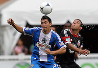WASHINGTON, D.C. - AUGUST 19, 2012:  Nick DeLeon (18) of DC United goes for a high ball with Michael Farfan (21) of the Philadelphia Union during an MLS match at RFK Stadium, in Washington DC, on August 19. The game ended in a 1-1 tie.