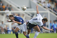 Gregg Berhalter and Miroslav Klose collide on a header. The USA lost to Germany 1-0 in the Quarterfinals of the FIFA World Cup 2002 in South Korea on June 21, 2002.