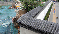 The destoyed Che Nian Hutong lies hidden from passers-by behind a beautiful Chinese wall. Thousands of old style hutongs have been, and are being detroyed, as the city has developed. A few people fight to remain and get a respectable price for their homes before they are forced out. As the Olympics have approached the Government have built high walls to keep Hutongs from the eyes of Olympic tourists..13 Aug 2008