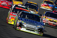 Mar. 1, 2009; Las Vegas, NV, USA; NASCAR Sprint Cup Series driver Jimmie Johnson leads the field during the Shelby 427 at Las Vegas Motor Speedway. Mandatory Credit: Mark J. Rebilas-