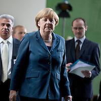 Bundeskanzlerin Angela Merkel (CDU) kommt am Dienstag (25.05.13) im Bundeskanzleramt in Berlin nach dem 6. Integrationsgipfel zu einer Pressekonferenz..Foto: Axel Schmidt/CommonLens