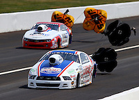 Aug. 31, 2013; Clermont, IN, USA: NHRA pro stock driver Larry Morgan (near) alongside Greg Stanfield during qualifying for the US Nationals at Lucas Oil Raceway. Mandatory Credit: Mark J. Rebilas-