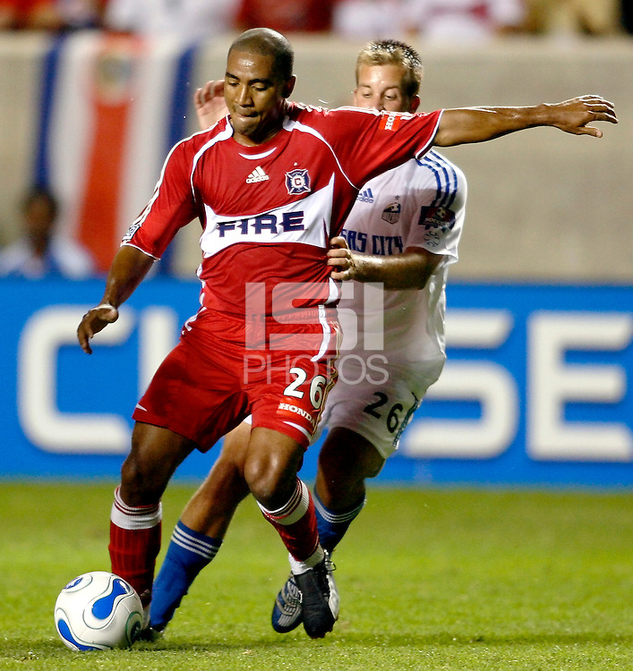 Chicago Fire forward Andy Herron (26) prepares to kick the ball in front of Kansas City Wizards defender Ryan Raybould (26).  The Chicago Fire defeated the Kansas City Wizards 3-0 at Toyota Park in Bridgeview, IL on August 16, 2006.