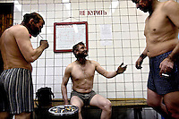 Miners smoke after finishing a shift at the Severny pit, one of five coal mines still operating around Vorkuta. A decade ago there were 13. On the wall behind them it is written: 'No Smoking'. Vorkuta is a coal mining and former Gulag town established beyond the Arctic Circle, where temperatures in winter drop to -50C. Russia's far north is slowly declining. Every year thousands of people from its towns and cities flee south. The system of subsidies that propped up Siberia and the Arctic in Soviet times has crumbled. Now there is no advantage to living in the far north, salaries are no higher than in central Russia and prices for goods are higher. /Felix Features