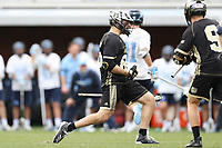 CHAPEL HILL, NC - MARCH 10: Trevor Weingarten #85 of Bryant University reacts after scoring a goal during a game between Bryant and North Carolina at Dorrance Field on March 10, 2020 in Chapel Hill, North Carolina.