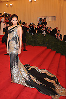 Nina Dobrev at the 'Schiaparelli And Prada: Impossible Conversations' Costume Institute Gala at the Metropolitan Museum of Art on May 7, 2012 in New York City. © mpi03/MediaPunch Inc.