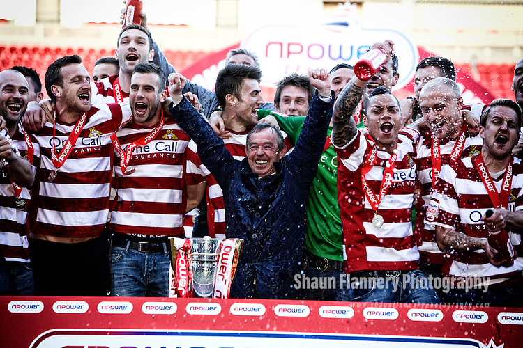 Pix: Shaun Flannery/shaunflanneryphotography.com...COPYRIGHT PICTURE>>SHAUN FLANNERY>01302-570814>>07778315553>>..29th April 2013..Doncaster Rovers celebrate after being presented with the npower league 1 trophy at the Keepmoat Stadium.]Rovers Manager Brian Flynn leads the celebrations.