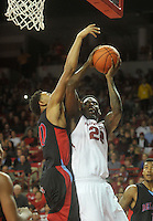 NWA Media/Michael Woods --11/21/2014-- w @NWAMICHAELW...University of Arkansas' Jacorey Williams is fouled by Delaware State defender Kavon Waller as he drives to the hoop during the first half of Friday nights game  against Delaware State at Bud Walton Arena in Fayetteville.