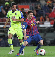 10.04.2012 Bacelona, Spain. La Liga. Picture show Leo Messi (R) and Rodriguez (L)  in action during match between FC Barcelona against Getafe at Camp Nou