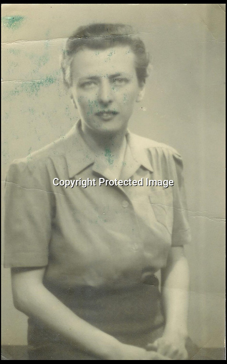 BNPS.co.uk (01202 558833)<br /> Pic: BourneEnd/BNPS<br /> <br /> ***Please use full byline***<br /> <br /> Mrs Imeson in 1944.<br /> <br /> A Rolex watch worn by a British prisoner of war during the infamous 'Great Escape' attempt is tipped to sell for &pound;30,000.<br /> <br /> Despite being held in the Stalag Luft III camp in Germany, Flight Lieutenant Gerald Imeson was still able to order and take delivery of a brand new watch in 1942.<br /> <br /> The famous Swiss watchmaker had offered all British officers one of their timepieces to replace the ones seized by the Germans and they could be paid for after the war.<br /> <br /> F/Lt Imeson helped dig the three tunnels for the audacious escape attempt of 1944.