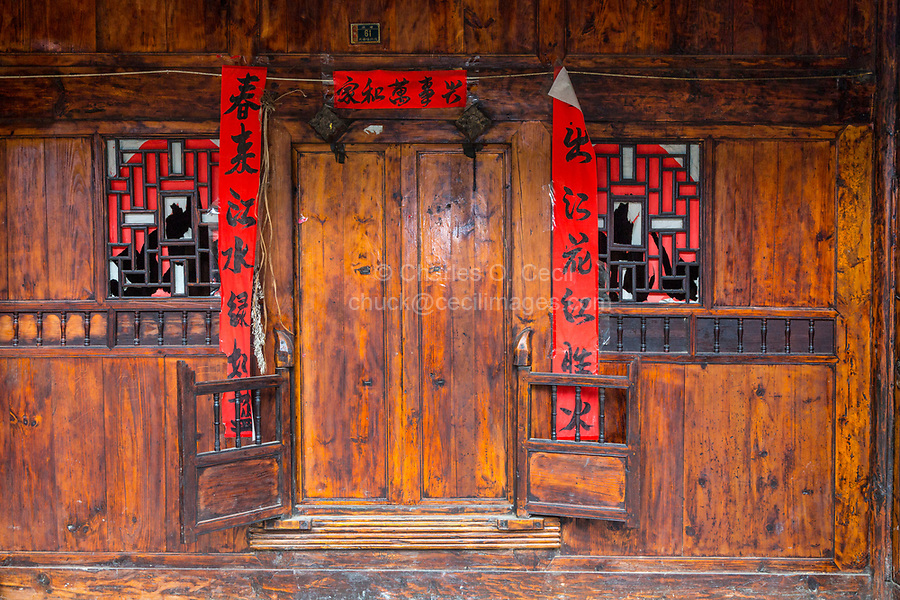 Matang, a Gejia Village in Guizhou, China.  Doorway to Private Home with Spring Festival (New Year) Scrolls Quoting Poetry by Bai Juyi.