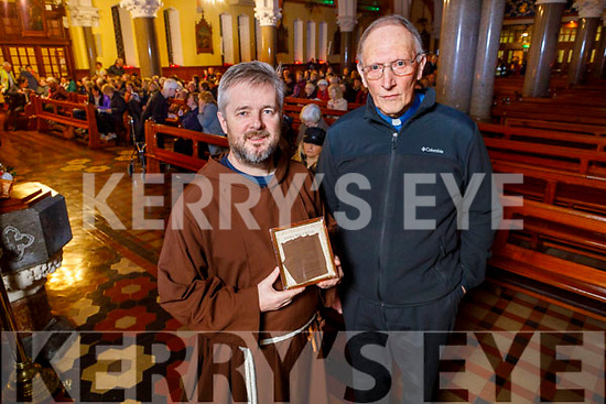 Brother Bryan Shortall OFM, Irish Capuchin provincial and Fr Mossie Brick, Parish Priest of Casteisland with the healing glove of Padre Pio at the first of the monthly devotions to Padre Pio in St Stephen and St John's Church in Castleisland on Tuesday.