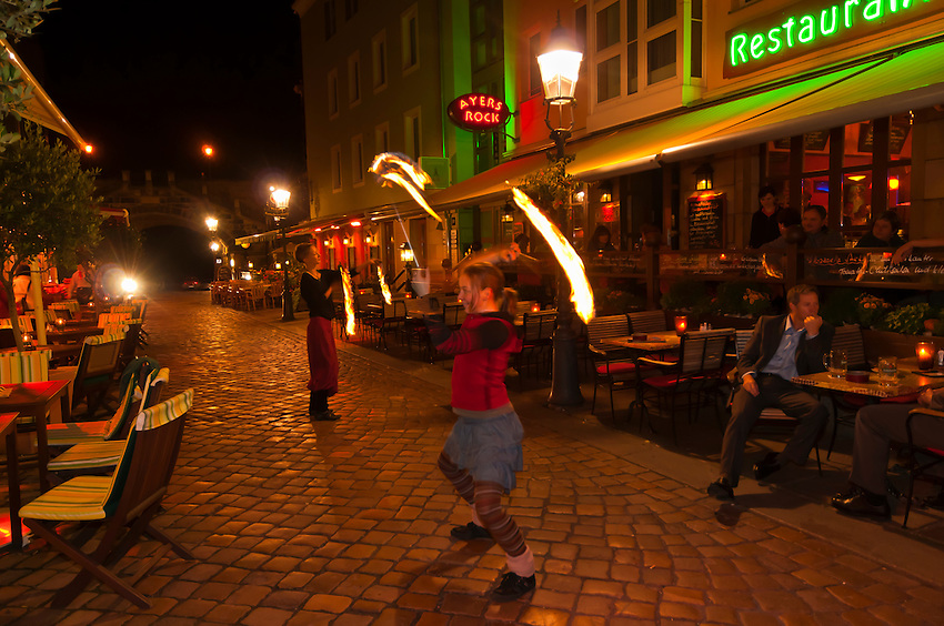 Girls twirling fire (performance) on Munzgasse in the Altstadt (old city), Dresden, Saxony, Germany