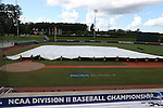 31 May 2016: The grounds crew pulls the tarp over the infield during a pregame lightning delay. The Nova Southeastern University Sharks played the Lander University Bearcats in Game 8 of the 2016 NCAA Division II College World Series  at Coleman Field at the USA Baseball National Training Complex in Cary, North Carolina. Nova Southeastern won the game 12-1.