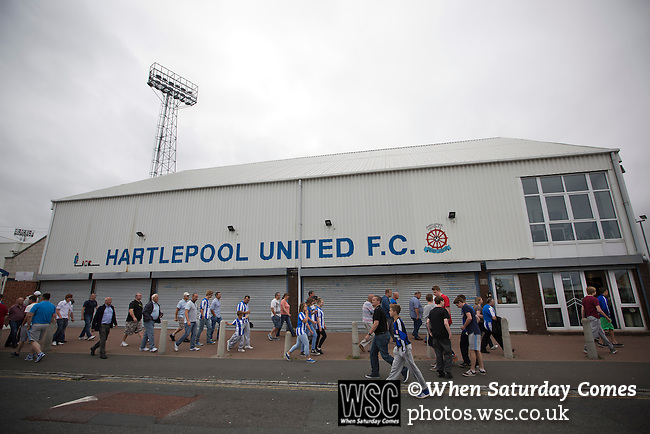 Hartlepool United 0 Middlesbrough 0, 20/07/2013. Victoria Ground, Pre-Season Friendly. Supporters of Hartlepool United and Middlesbrough making their way past the main entrance at the Victoria Ground, Hartlepool, after the pre-season friendly between the two teams. Hartlepool were relegated to League Two at the end of the 2012-13 season whilst their Teesside neighbours remained two divisions above them in the Championship. The game ended in a no-score draw watched by a crowd of 2307. Photo by Colin McPherson.