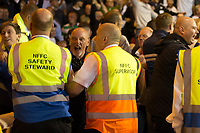 Millwall fans clash with stewards after invading the pitch in the aftermath of Steve Morison's goal during the Sky Bet Championship match between Nottingham Forest and Millwall at the City Ground, Nottingham, England on 4 August 2017. Photo by James Williamson / PRiME Media Images.