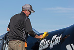 Mechanic Tom Macy polishes Six-Cat during the National Championship Air Races in Reno, Nevada on Wednesday, September 13, 2017.