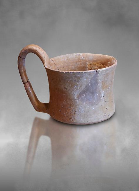 Hittite terra cotta big handled tankard mug. Hittite Empire, Alaca Hoyuk, 1450 - 1200 BC. Alaca Hoyuk. Çorum Archaeological Museum, Corum, Turkey. Against a grey bacground.