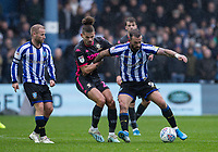 Leeds United's Kalvin Phillips (centre) competing with Sheffield Wednesday's Steven Fletcher (right) <br /> <br /> Photographer Andrew Kearns/CameraSport<br /> <br /> The EFL Sky Bet Championship - Sheffield Wednesday v Leeds United - Saturday 26th October 2019 - Hillsborough - Sheffield<br /> <br /> World Copyright © 2019 CameraSport. All rights reserved. 43 Linden Ave. Countesthorpe. Leicester. England. LE8 5PG - Tel: +44 (0) 116 277 4147 - admin@camerasport.com - www.camerasport.com