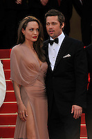 ANGELINA JOLIE &amp; BRAD PITT<br /> The &quot;Inglourious Basterds&quot; Premiere at the Grand Theatre Lumiere during the 62nd Annual Cannes Film Festival, Cannes, France.<br /> May 20th, 2009<br /> length half 3/4 dress sheer wrap beige pink cream black tuxedo couple goatee facial hair slit split thigh<br /> CAP/PL<br /> &copy;Phil Loftus/Capital Pictures /MediaPunch ***NORTH AND SOUTH AMERICAS ONLY***