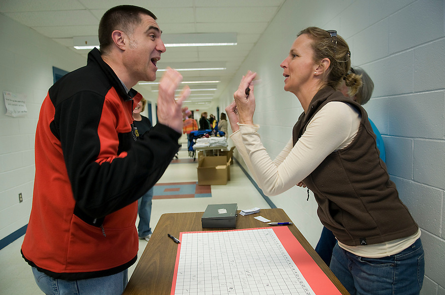 """GOFFSTOWN, N.H.--April 9, 2009-Patty Easton, r, works to convince Lee Steckowych, l, to buy """"Donkey Poop Squares"""" as a fundraiser for the school. The winner is determined by where the donkey leaves his excrement. JODI HILTON FOR THE NEW YORK TIMES"""