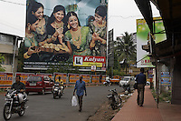 Banner advertisement in Indian street showing gold at a wedding celebration. Per capita consumption of gold is highest in Kerala over all of India. ..In Thrissur at the Raj Jewelry Works..Job Workers for Joyalukkas.