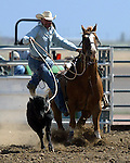 Larry Mikita competes in tie down roping at the Southeast Weld County CPRA Rodeo in Keenesburg, Colorado on August 12, 2006.