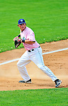 """18 July 2010: Vermont Lake Monsters third baseman Jack Walker in action against the Staten Island Yankees at Centennial Field in Burlington, Vermont. The Lake Monsters, dressed in their Breast Cancer Awareness """"Pinks"""", fell to the Yankees 9-5 in NY Penn League action. Mandatory Credit: Ed Wolfstein Photo"""