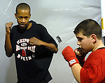 FREEPORT,NY-JANUARY 24, 2007: Patrick Day, 14, of Freeport, gives advice on boxing stance to Michael Florio, 12, of Oceanside, at the Freeport Police Athletic League Gym in Northeast Park in Freeport on Wednesday,  January 24, 2007. (Newsday Photo / Jim Peppler).