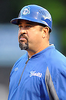 Asheville Tourists manager Fred Ocasio #28 during a game against the  Kannapolis Intimidators at McCormick Field on May 9, 2013 in Asheville, North Carolina. The Intimidators won the game 13-12. (Tony Farlow/Four Seam Images).