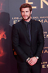 """Australian actor Liam Hemsworth poses for the photographers during the Spain premiere of the movie """"The Hunger Games: Catching Fire"""" at Callao Cinema in Madrid, Spain. November 13, 2013. (ALTERPHOTOS/Victor Blanco)"""