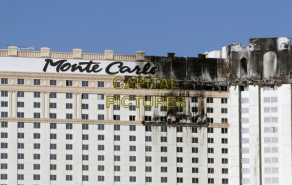 THE MONTE CARLO HOTEL & CASINO.The Monte Carlo Casino Resort in Las Vegas first reported a fire on the roof about 11:00 in the morning. By noon, the fire had spread across the roof. A multi-alarm high rise fire alarm went out. Fire departments from the area. The fire was mainly on the outside facade of the building. The elevators were shut off. Fire Fighters had to climb 34 stories carrying equipment to fight the fire. The fire was extinguished at about 12:30. No injuries are reported. The Casino is owned and operated by MGM Mirage, which operates many of the large resorts on the strip, Las Vegas, Nevada, USA..January 26th, 2008.gv g.v. general view building burn burnt .CAP/ADM/MJT.©MJT/AdMedia/Capital Pictures. *** Local Caption *** .