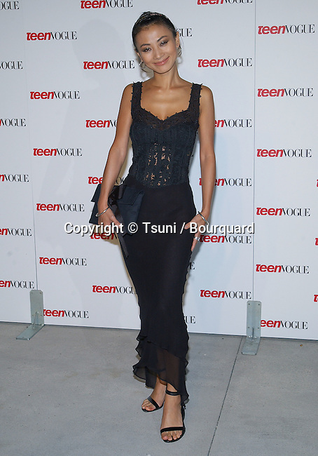 """Bai Ling arriving at the """" TEEN VOGUE 1ST ANNUAL YOUNG HOLLYWOOD ISSUE """" in  a private residence in Beverly Hills (Los Angeles). September 5, 2003."""